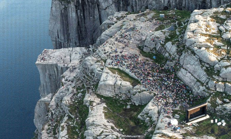 "NORWAY OUTMandatory Credit: Photo by Carina Johansen/EPA-EFE/REX/Shutterstock (9776598b)People gathered in the mountain near Preikestolen (The Pulpit Rock) in Forsand near Stavanger, to see the movie ""Mission: Impossible - Fallout"" in  western Norway, 01 August 2018, Some of the scenes in the movie was filmed at the Norwegian landmark last November.The Pulpit Rock in Forsand featured in Mission Impossible movie, Norway - 01 Aug 2018"