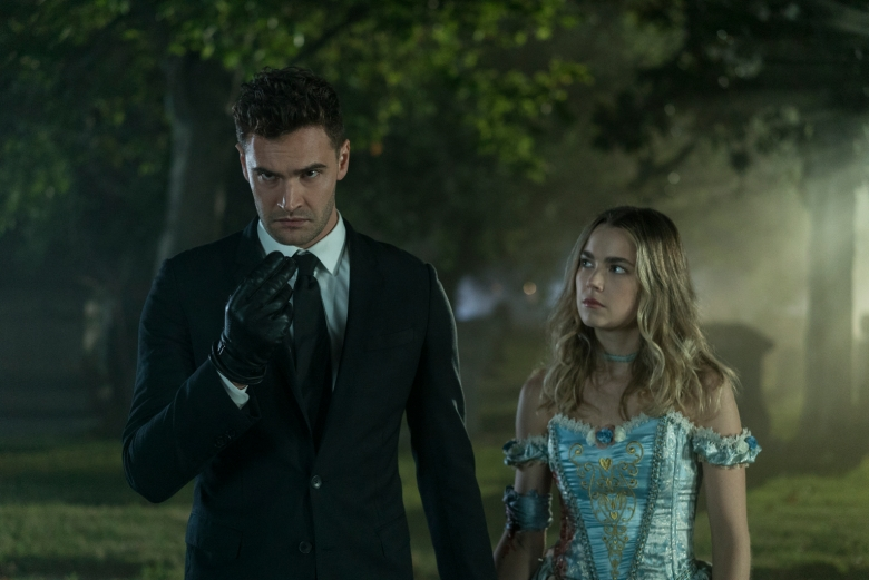 """Into The Dark -- """"The Body"""" - A sophisticated hitman with a cynical view on modern society finds his work made more difficult when he has to transport a body on Halloween night, but everyone is enamored by what they think is his killer costume. Wilkes (Tom Bateman) and Maggie (Rebecca Rittenhouse), shown. (Photo by: Richard Foreman, Jr.  SMPSP/Hulu)"""