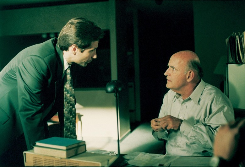 """A man with psychic powers (Peter Boyle, R) assists agents Mulder (David Duchovny, L) and Scully (Gillian Anderson, not pictured) with the hunt for a killer in THE X-FILES episode """"Clyde Bruckman's Final Repose"""" which originally aired on Sunday, Oct. 13, 1995."""