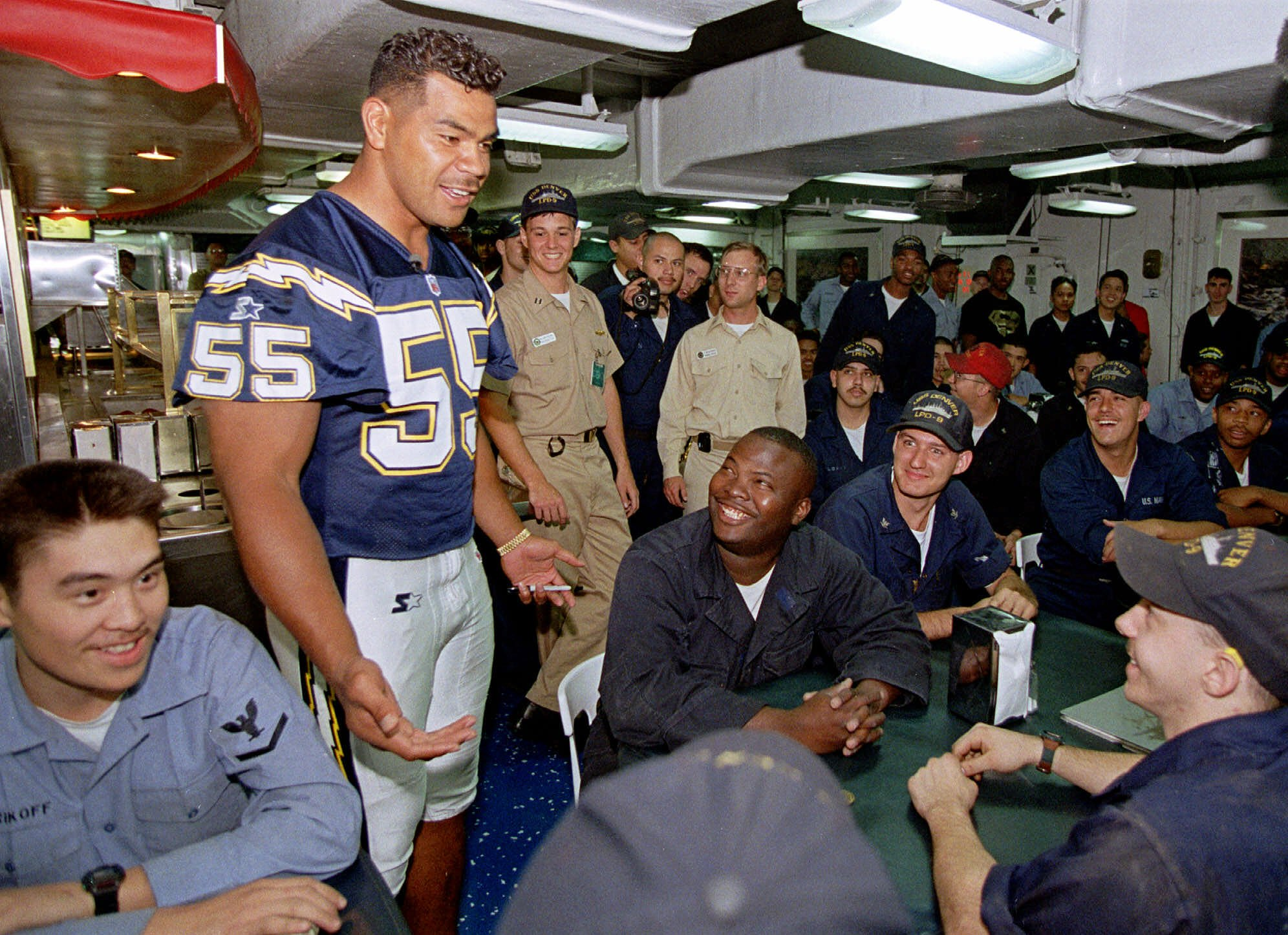 SEAU San Diego Chargers defensive back Junior Seau jokes with sailors in the mess hall aboard the USS Denver, which is docked at the 32nd Street Naval Station in San Diego, . Seau and teammates came aboard the ship to sign autographs and thank fans for their support after last year's losing season. The visit is part of a three-day Chargers campaign to enlist fan support for the coming seasonCHARGERS FANS, SAN DIEGO, USA