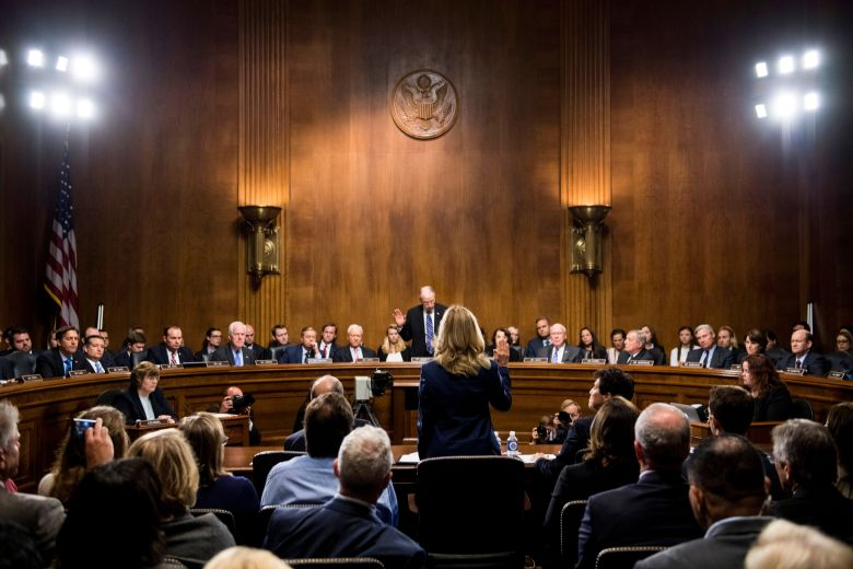 Christine Blasey Ford is sworn in by Senate Judiciary Committee chairman Chuck Grassley, R-Iowa, to testify before the Senate Judiciary Committee on Capitol Hill in WashingtonSupreme Court Kavanaugh, Washington, USA - 27 Sep 2018