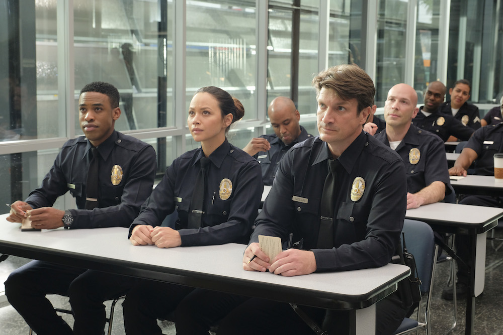 "THE ROOKIE - ""Pilot"" - Starting over isn't easy, especially for small-town guy John Nolan who, after a life-altering incident, is pursuing his dream of being a police officer, on the premiere episode of ""The Rookie,"" airing TUESDAY, OCT. 16 (10:00-11:00 p.m. EDT), on The ABC Television Network. (ABC/Tony Rivetti)TITUS MAKIN, MELISSA O'NEIL, NATHAN FILLION"