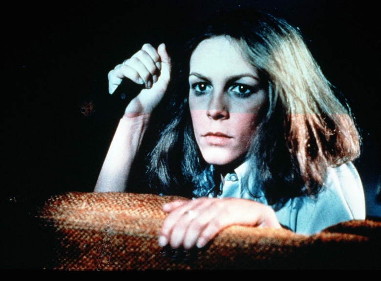 Editorial use onlyMandatory Credit: Photo by ITV/REX/Shutterstock (794253b) 'Halloween' Film - 1978 - Laurie Strode (Jamie Lee Curtis) looking over the top of a sofa with a knife in her right hand. GTV ARCHIVE