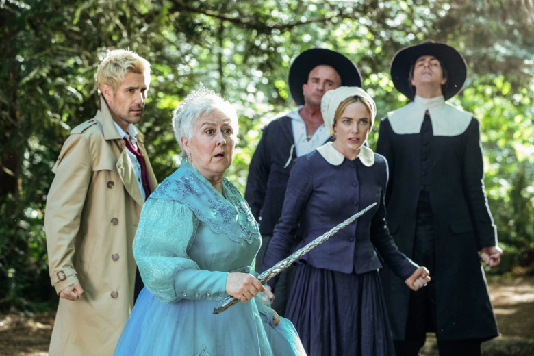 "DC's Legends of Tomorrow -- ""Witch Hunt"" -- Image Number: LGN402b_0680b.jpg -- Pictured (L-R): Matt Ryan as Constantine, Jane Carr as Godmother, Dominic Purcell as Mick Rory/Heat Wave, Caity Lotz as Sara Lance/White Canary and Brandon Routh as Ray Palmer/Atom -- Photo: Jack Rowand/The CW -- © 2018 The CW Network, LLC. All Rights Reserved."