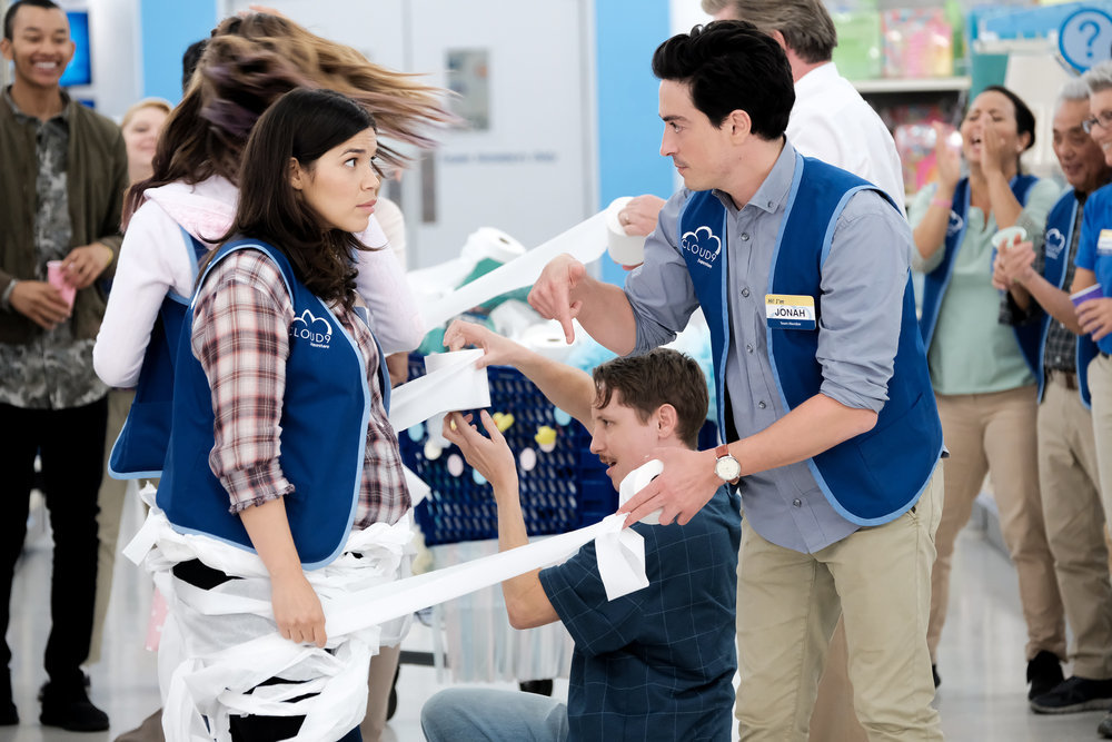 "SUPERSTORE -- ""Baby Shower"" Episode 402 -- Pictured: (l-r) America Ferrera as Amy, Ben Feldman as Jonah -- (Photo by: Eddy Chen/NBC)"