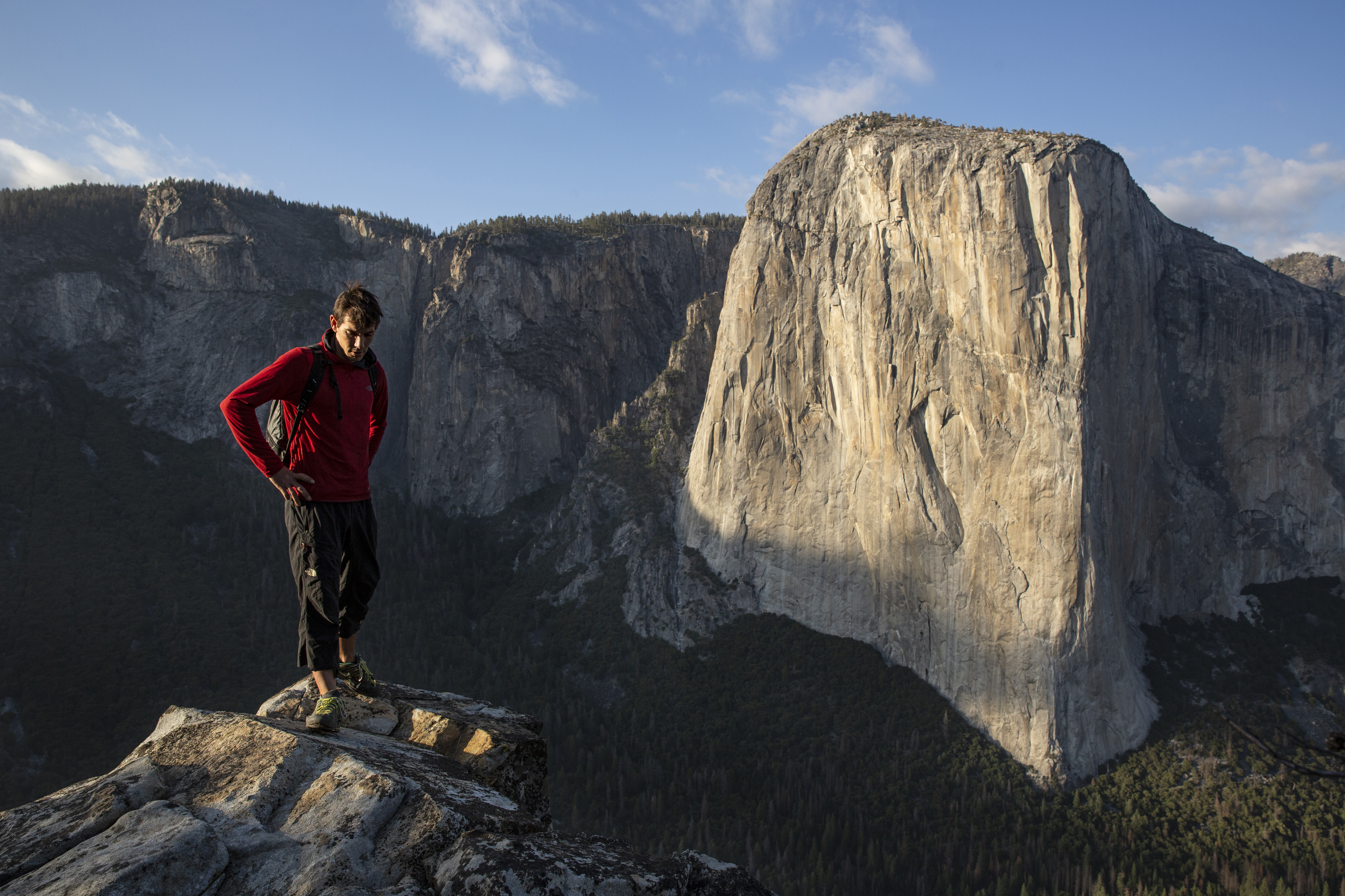 Alex Honnold atop Lower Cathedral with El Capitan in the background, Yosemite National Park, CA. (National Geographic/Samuel Crossley)