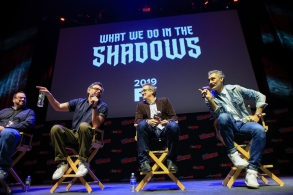 """NEW YORK - OCTOBER 7: (L-R) Moderator Alan Sepinwall, executive producers Jemaine Clement, Paul Simms and Taika Waititi speak at the panel for """"What We Do in the Shadows"""" at the 2018 NY Comic-Con on October 7, 2018 in New York City. (Photo by Kena Betancur/Fox/PictureGroup)"""