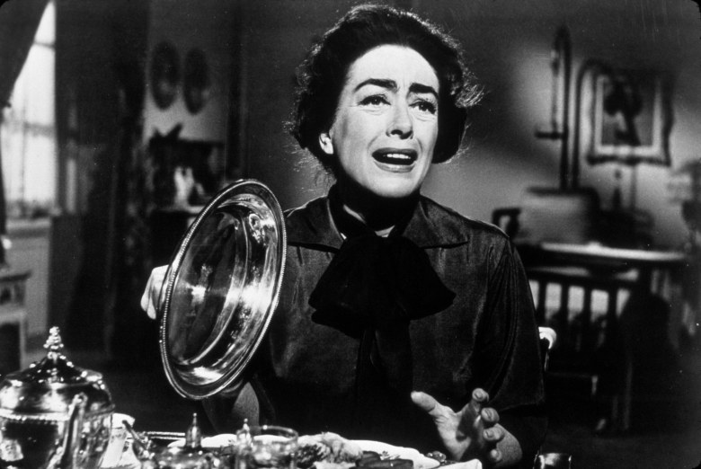 Editorial use onlyMandatory Credit: Photo by SNAP/REX/Shutterstock (390848p)FILM STILLS OF 'WHAT EVER HAPPENED TO BABY JANE?' WITH 1962, AIRPLANE, ROBERT ALDRICH, JOAN CRAWFORD, DINING ROOM TABLE, GRIMACE IN 1962VARIOUS