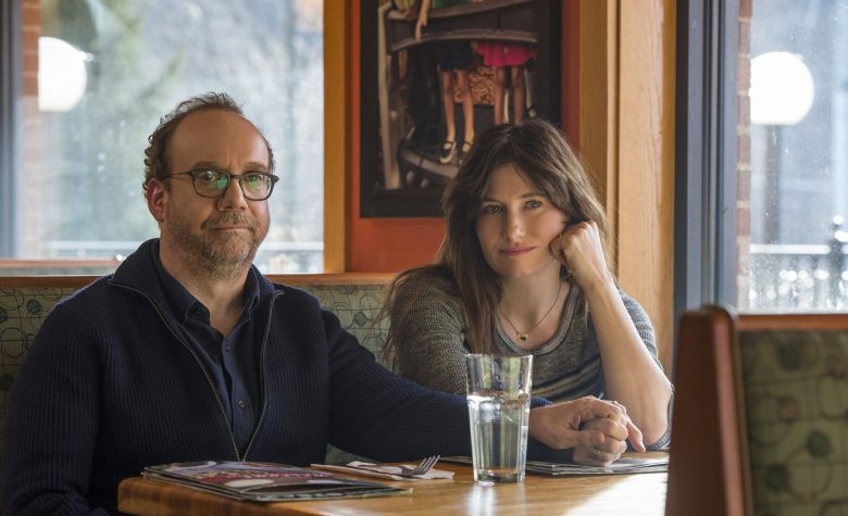 "This image released by Netflix shows Paul Giamatti, left, and Kathryn Hahn in a scene from ""Private Life."" (Jojo Whilden/Netflix via AP)"
