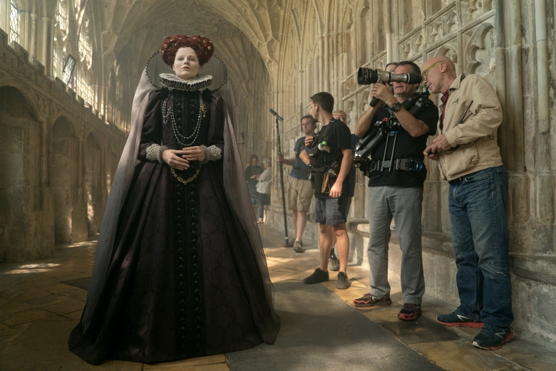 "Actor Margot Robbie (left), Director of Photography John Mathieson (right) and crew members on the set of ""Mary Queen of Scots"""