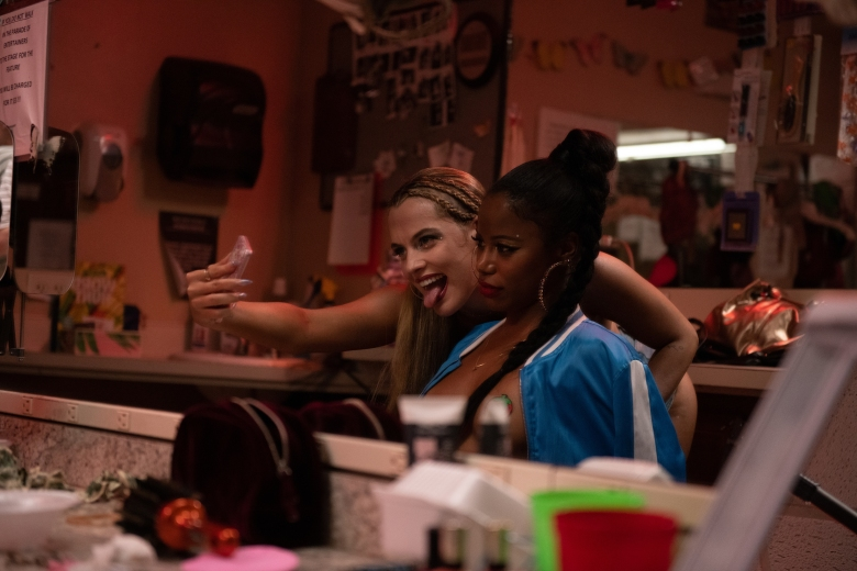 """Riley Keough (left) stars as """"Stefani"""" and Taylour Paige (right) stars as """"Zola"""" in director Janicza Bravo's ZOLA, an A24 Films release. Cr. Anna Kooris / A24 Films"""
