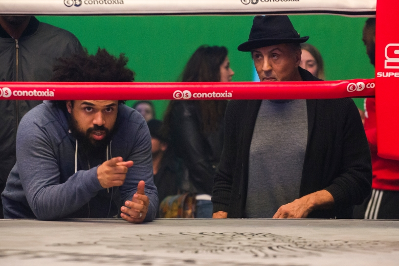 Director Steven Caple Jr. and Sylvester Stallone on the set of CREED II, a Metro Goldwyn Mayer Pictures and Warner Bros. Pictures film.Credit: Barry Wetcher / Metro Goldwyn Mayer Pictures / Warner Bros. Pictures© 2018 Metro-Goldwyn-Mayer Pictures Inc. and Warner Bros. Entertainment Inc.All Rights Reserved.