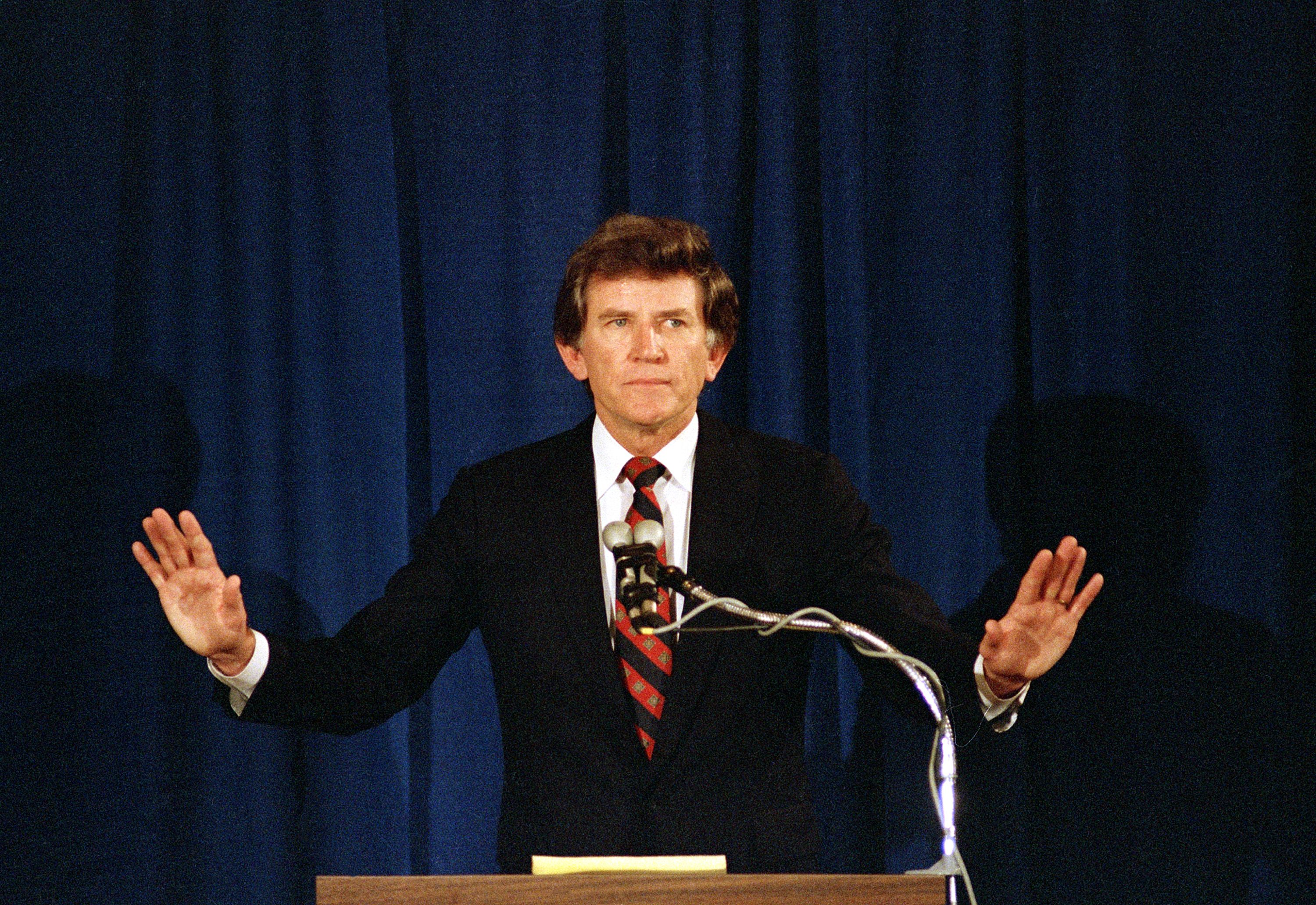 Former U.S. Senator Gary Hart waves his arms to quiet applause from supporters, during a press conference announcing his withdrawal from the Democratic presidential race, Denver, Colo., May 8. 1987GARY HART WITHDRAWS, DENVER, USA