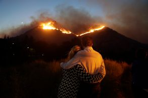 Rober Bloxberg, Anne Bloxberg. Roger Bloxberg, right, and his wife Anne hug as they watch a wildfire on a hill top near their home, in West Hills, CalifCalifornia Wildfires, West Hills, USA - 09 Nov 2018