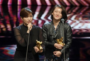 """Taiwanese director Fu Yuen, left, delivers a speech after she won Best Documentary at the 55th Golden Horse Awards in Taipei, Taiwan, . Fu won for the film """"Our Youth in Taiwan"""" at this year's Golden Horse Awards -the Chinese-language film industry's biggest annual eventsGolden Horse Awards, Taipei, Taiwan - 17 Nov 2018"""