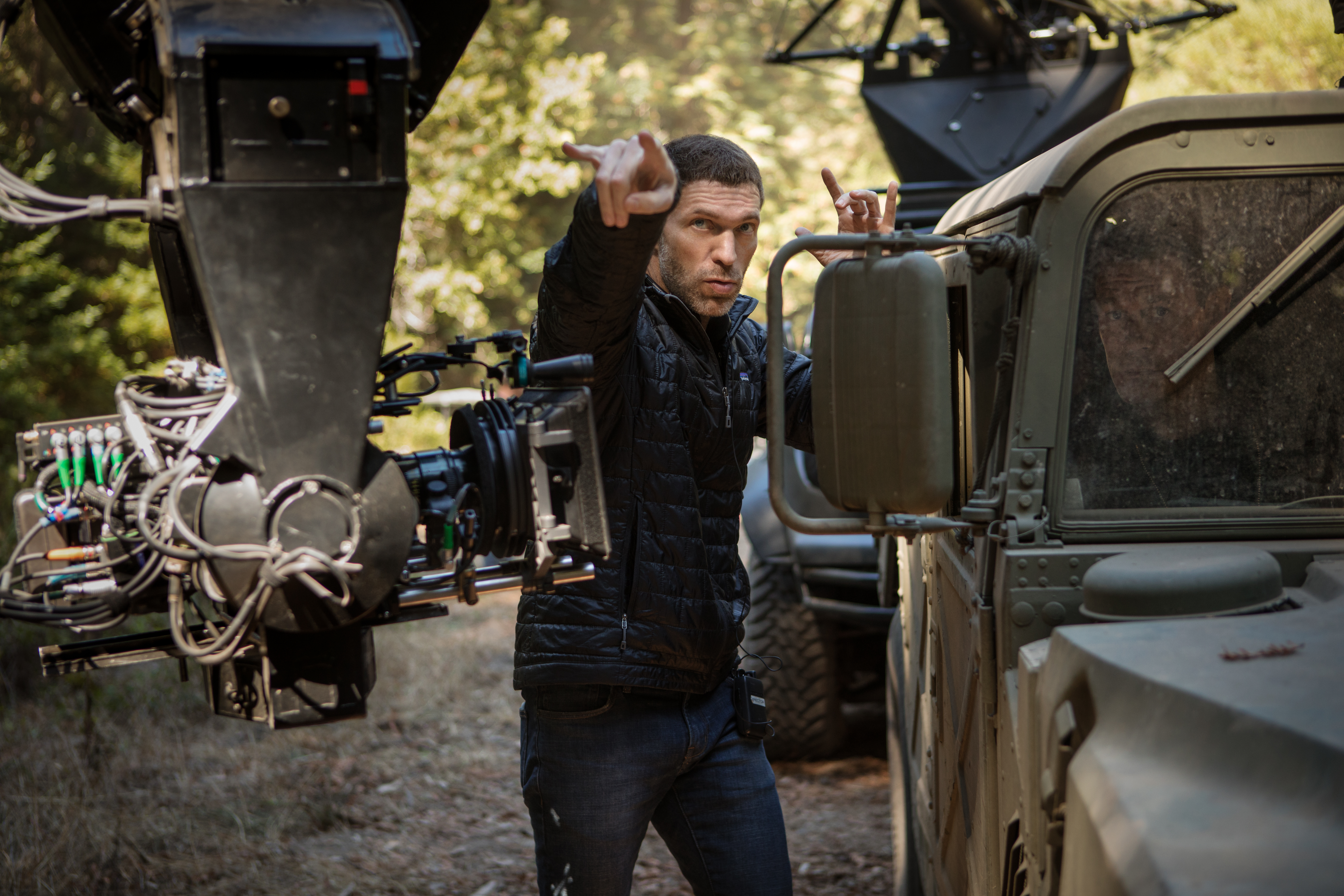 Left to right: Director Travis Knight and John Cena behind the scenes on the set of BUMBLEBEE, from Paramount Pictures.