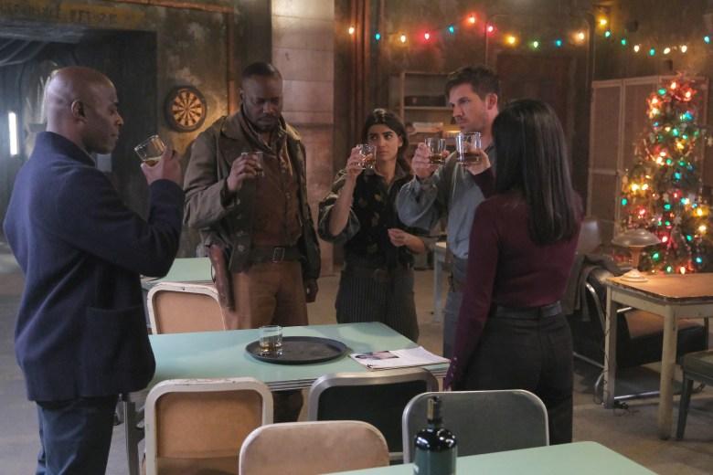 "TIMELESS -- ""The Miracle of Christmas Part l "" Episode 211 -- Pictured: (l-r) Paterson Joseph as Connor Mason, Malcolm Barrett as Rufus Carlin, Claudia Doumit as Jiya, Matt Lanter as Wyatt Logan -- (Photo by: Darren Michaels/Sony/NBC)"