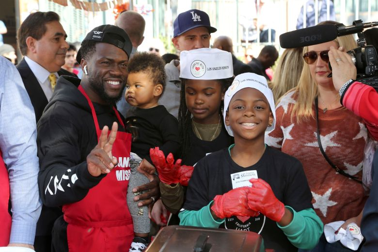 Kevin Hart, Heaven Hart, Hendrix Hart. Kevin Hart, from left, daughter Heaven Hart and son Hendrix Hart volunteer to serve Thanksgiving dinner to a group of homeless people at the Los Angeles Mission, in Los Angeles2018 Mission's Thanksgiving Dinner, Los Angeles, USA - 21 Nov 2018