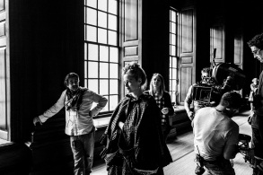 First Assistant Director Atilla Salih Yücer and Emma Stone on the set of THE FAVOURITE. Photo by Yorgos Lanthimos.© 2018 Twentieth Century Fox Film Corporation All Rights Reserved