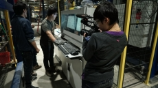 "Yiqian Zhang shooting ""American Factory"" with a Canon C100 MK 2"