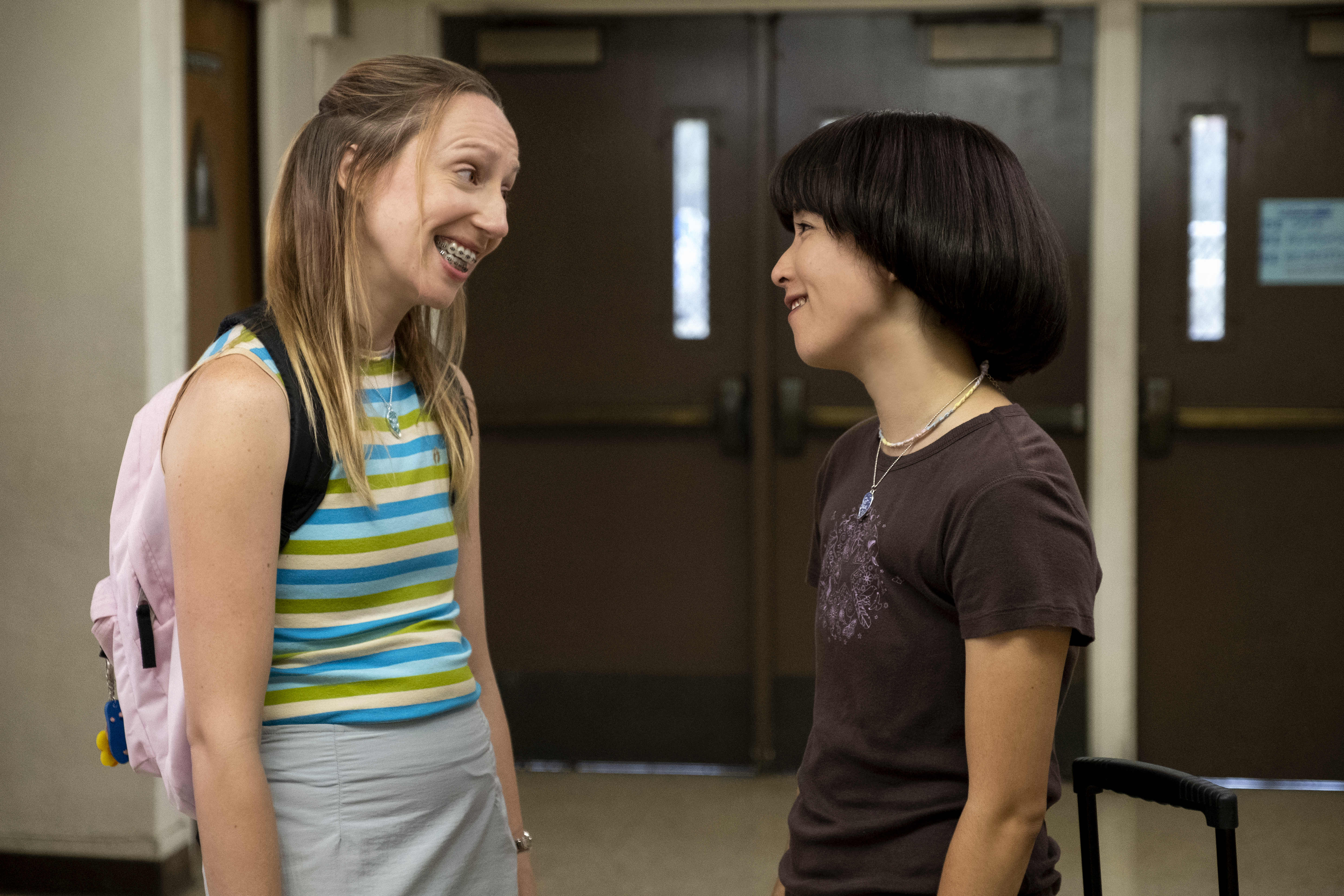 "PEN15 -- ""First Day"" - Episode 101 - ItÕs the first day of seventh grade in the year 2000. School rejects, Anna and Maya, get a lot of unexpected attention. Anna Kone (Anna Konkle) and Maya Ishii-Peters (Maya Erskine), shown. (Photo by: Alex Lombardi/Hulu)"