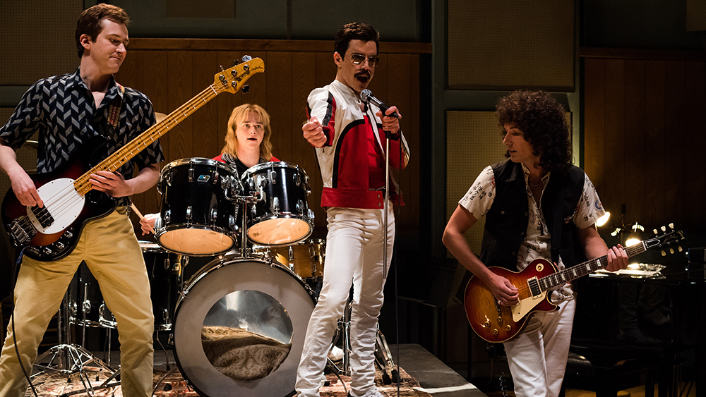 DF-25953 – L-R: Joe Mazzello (John Deacon), Ben Hardy (Roger Taylor), Rami Malek (Freddie Mercury), and Gwilym Lee (Brian May) star in Twentieth Century Fox's BOHEMIAN RHAPSODY. Photo Credit: Alex Bailey.