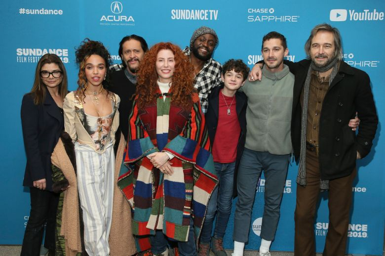 """Alma Har'el, Laura San Giacomo, FKA Twigs, Clifton Collins, Byron Bowers, Noah Jupe, Shia LaBeouf, Craig Stark. Director Alma Har'el, fourth from left, poses with actors from left to right, Laura San Giacomo, FKA Twigs, Clifton Collins, Byron Bowers, Noah Jupe, Shia LaBeouf, and Craig Stark at the premiere of """"Honey Boy"""" during the 2019 Sundance Film Festival, in Park City, Utah2019 Sundance Film Festival - """"Honey Boy"""" Premiere, Park City, USA - 25 Jan 2019"""