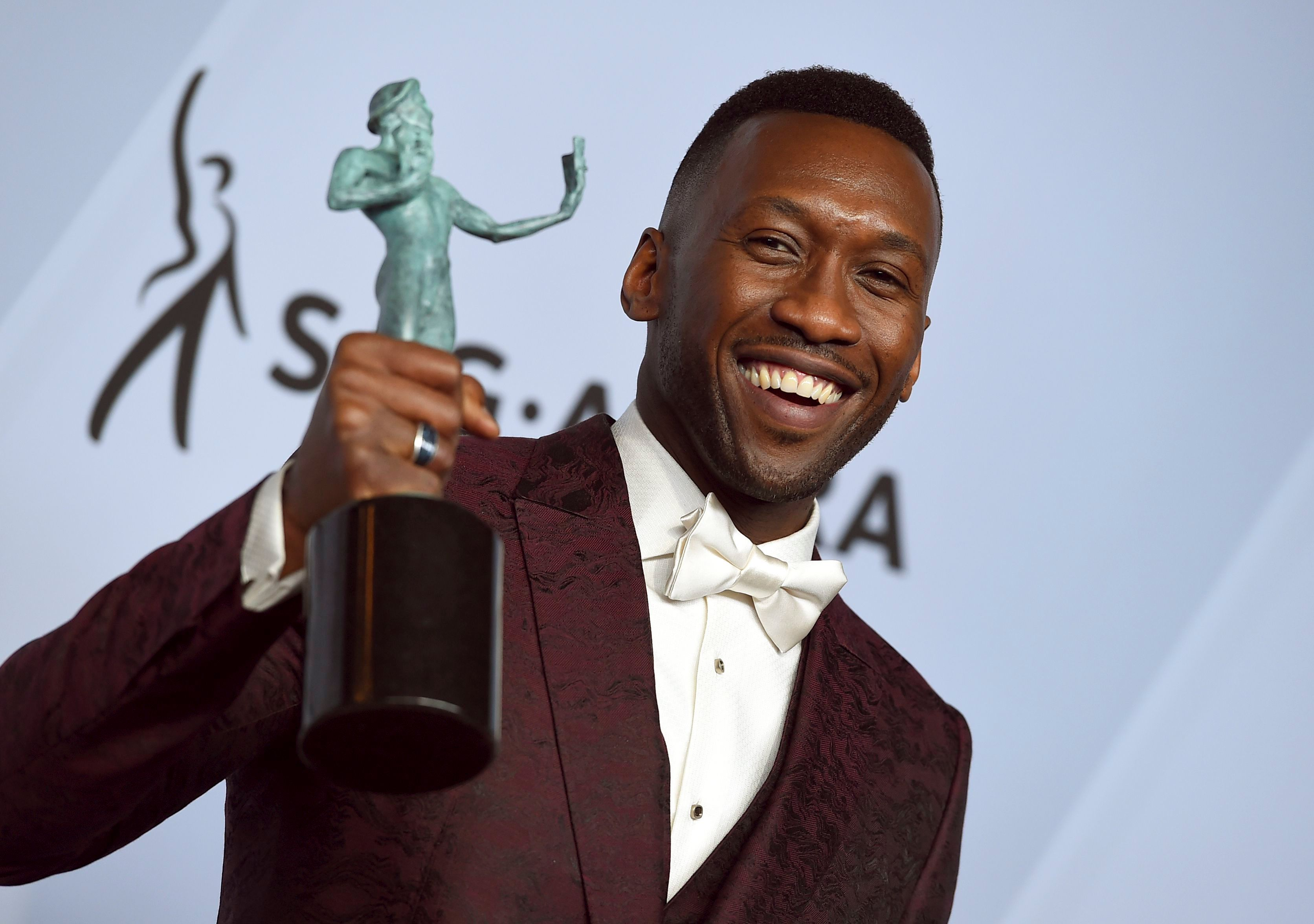 Mahershala Ali poses with the award for outstanding performance by a male actor in a supporting role for