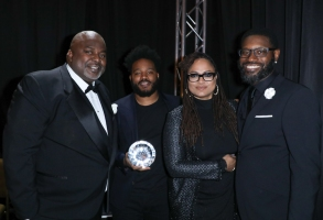 AAFCA co-founders Gil Robertson (right) and Shawn Edwards (left) flank winners Ryan Coogler and Ava DuVernay at the 10th Annual AAFCA Awards