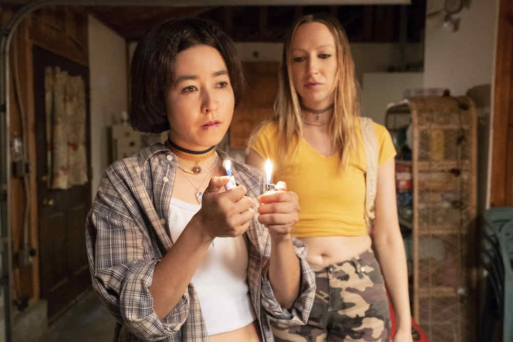 "PEN15 -- ""Miranda"" - Episode 102 - Maya and Anna become fascinated with the mature girls in their class who smoke. They are faced with the age old question: stay home and play pretend or go out and do drugs? Maya (Maya Erskine) and Anna (Anna Konkle), shown. (Photo by: Alex Lombardi/Hulu)"