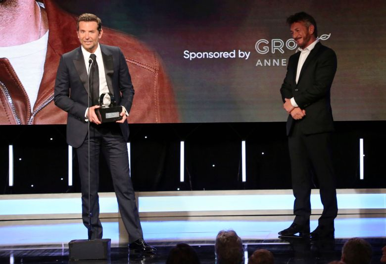 Bradley Cooper, Sean Penn. Honoree Bradley Cooper accepts his American Cinematheque Award as presenter Sean Penn looks on during a ceremony, at the Beverly Hilton Hotel in Beverly Hills, Calif2018 American Cinematheque Award Ceremony Honoring Bradley Cooper - Show, Beverly Hills, USA - 29 Nov 2018