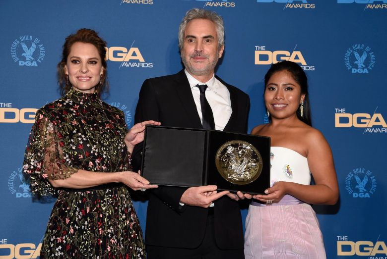 "Alfonso Cuaron, Marina De Tavira, Yalitza Aparicio. Director Alfonso Cuaron, center, poses in the press room holding a plaque for his feature film award nomination for ""Roma"" with actors from the film Marina De Tavira, left, and Yalitza Aparicio at the 71st annual DGA Awards at the Ray Dolby Ballroom, in Los Angeles71st Annual DGA Awards - Press Room, Los Angeles, USA - 02 Feb 2019"