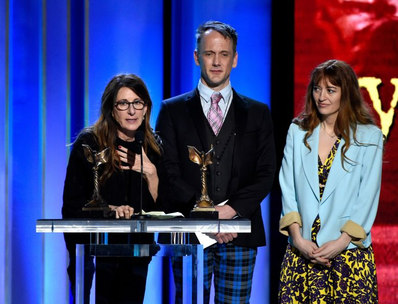 "Nicole Holofcener, Jeff Whitty, Marielle Heller. Nicole Holofcener, left, and Jeff Whitty accept the award for best screenplay for ""Can You Ever Forgive Me?"" with director Marielle Heller, right, looking on at the 34th Film Independent Spirit Awards, in Santa Monica, Calif2019 Film Independent Spirit Awards - Show, Santa Monica, USA - 23 Feb 2019"