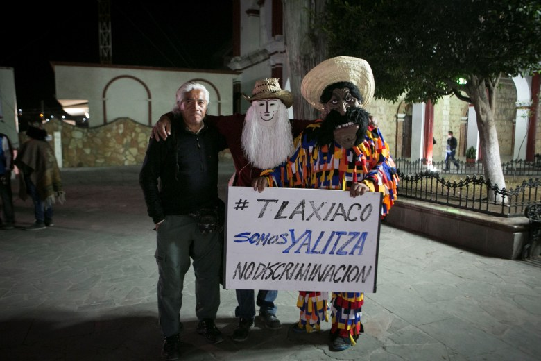 Inhabitants of the town of Tlaxiaco, in the state of Oaxaca, Mexico, birthplace of actress Yalitza Aparicio, pose with a poster against discrimination during the live broadcast of the Oscar awards, 24 February 2019. Alfonso Cuaron won Best Director Award, Best Achievement in Cinematography Award and Best Foreign Language Film Award for 'Roma'.Oscars viewing, Tlaxiaco, Mexico - 25 Feb 2019