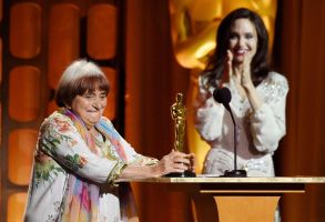 Agnes Varda, Angelina Jolie. French film director Agnes Varda, left, collects her honorary Oscar onstage as presenter Angelina Jolie applauds at the 2017 Governors Awards at The Ray Dolby Ballroom, in Los Angeles2017 Governors Awards - Show, Los Angeles, USA - 11 Nov 2017