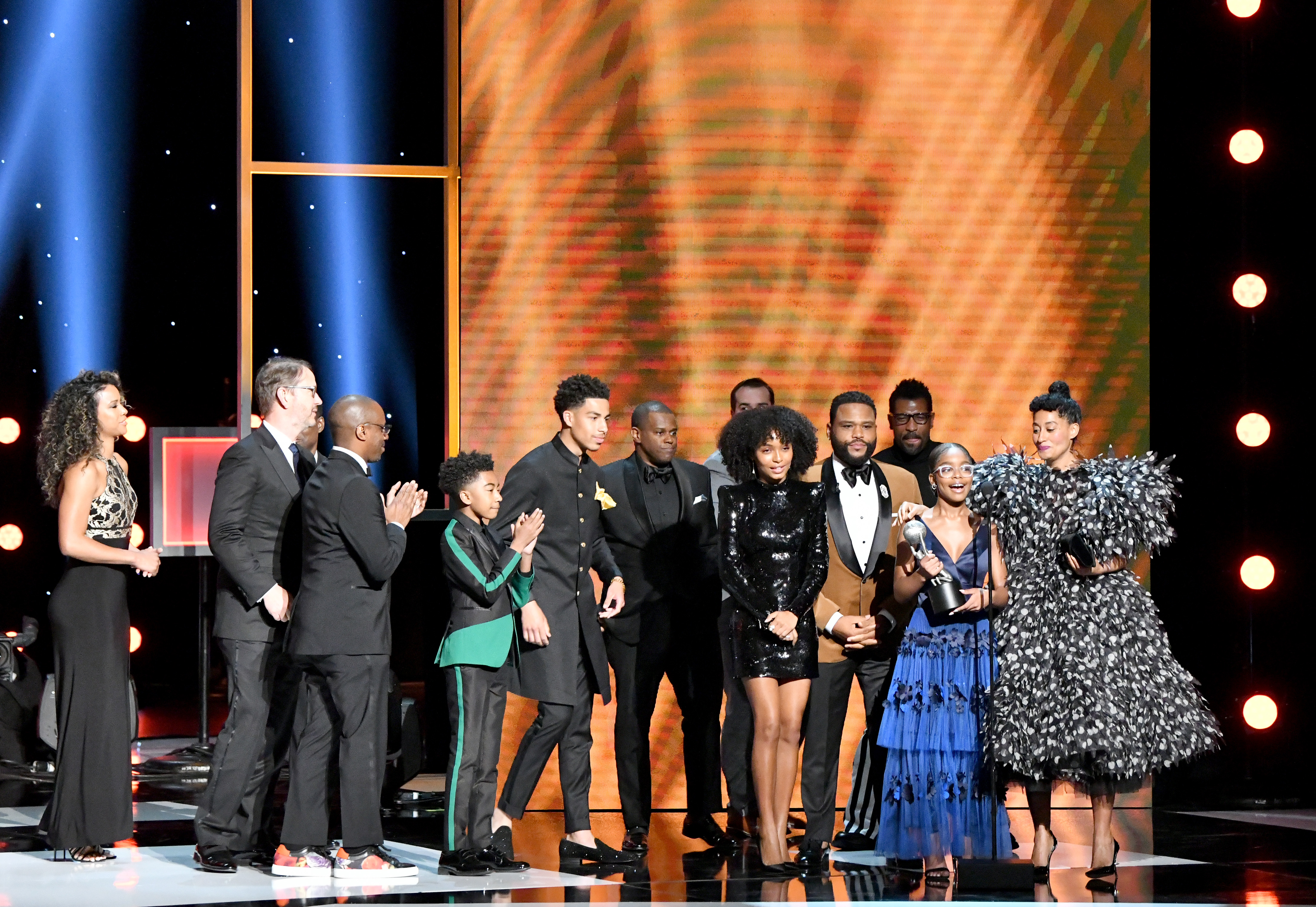 "HOLLYWOOD, CALIFORNIA - MARCH 30: Cast and crew of ""Black-ish"" accept the Outstanding Comedy Series award onstage at the 50th NAACP Image Awards at Dolby Theatre on March 30, 2019 in Hollywood, California. (Photo by Earl Gibson III/Getty Images for NAACP)"
