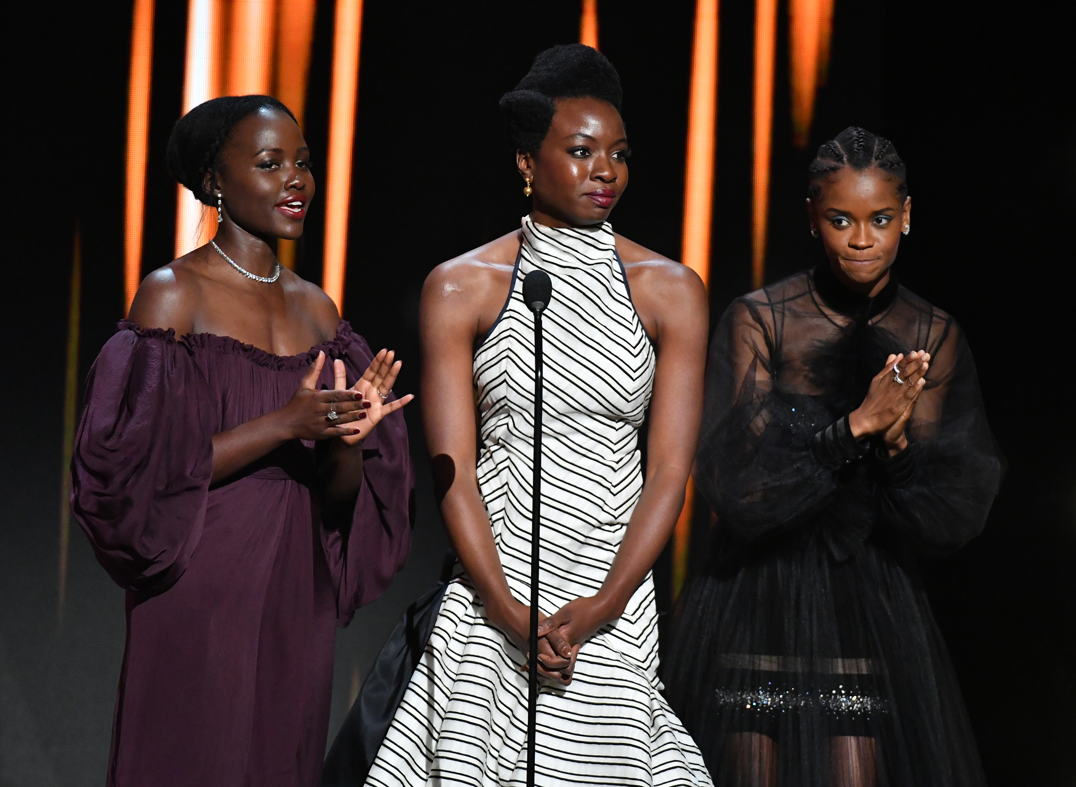 HOLLYWOOD, CALIFORNIA - MARCH 30: (L-R) Lupita Nyong'o, Danai Gurira, and Letitia Wright speak onstage at the 50th NAACP Image Awards at Dolby Theatre on March 30, 2019 in Hollywood, California. (Photo by Earl Gibson III/Getty Images for NAACP)
