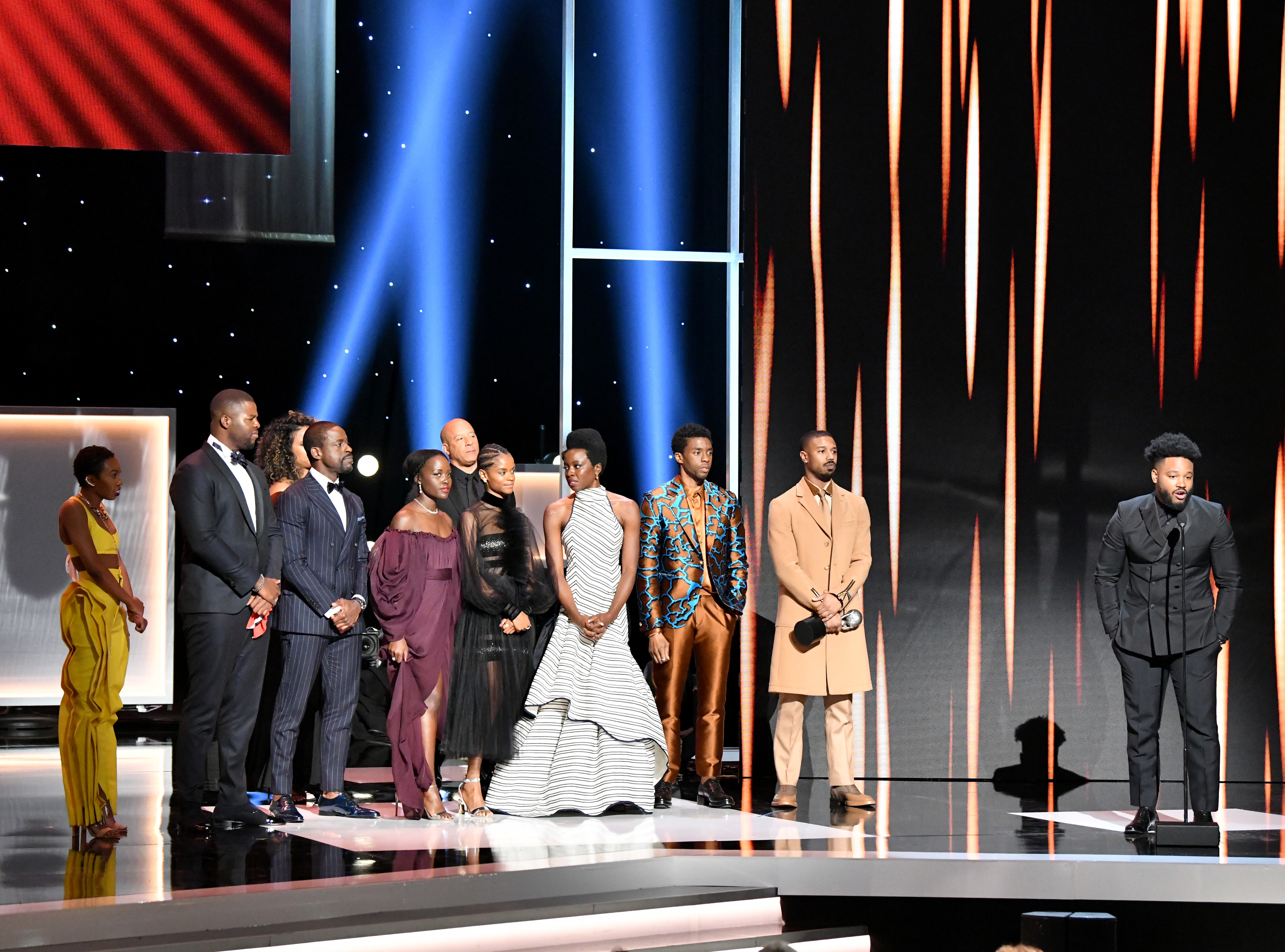 HOLLYWOOD, CALIFORNIA - MARCH 30: Vin Diesel (back center) listens while (from L) Carrie Bernans, Winston Duke, Sterling K. Brown, Lupita Nyong'o, Letitia Wright, Danai Gurira, Chadwick Boseman, Michael B. Jordan, and Ryan Coogler accept the Outstanding Motion Picture award for 'Black Panther' onstage at the 50th NAACP Image Awards at Dolby Theatre on March 30, 2019 in Hollywood, California. (Photo by Earl Gibson III/Getty Images for NAACP)