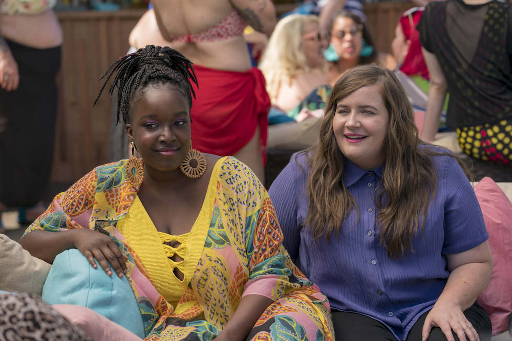 Shrill -- Episode 104 -- Annie & Fran attend the Fat Babe Pool Party. Annie is so empowered by the experience and so furious with her boss, Gabe, that she posts a body positive article to the paper's website that explains exactly what it's like to be a fat woman in today's world. Fran (Lolly Adefope), Annie (Aidy Bryant), shown. (Photo by: Allyson Riggs)