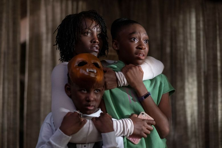 Editorial use only. No book cover usage.Mandatory Credit: Photo by C Barius/Universal/ILM/Kobal/REX/Shutterstock (10162635j)Evan Alex as Jason Wilson, Lupita Nyong'o as Adelaide Wilson and Shahadi Wright Joseph as Zora Wilson'Us' Film - 2019A family's serenity turns to chaos when a group of doppelgängers begins to terrorize them.