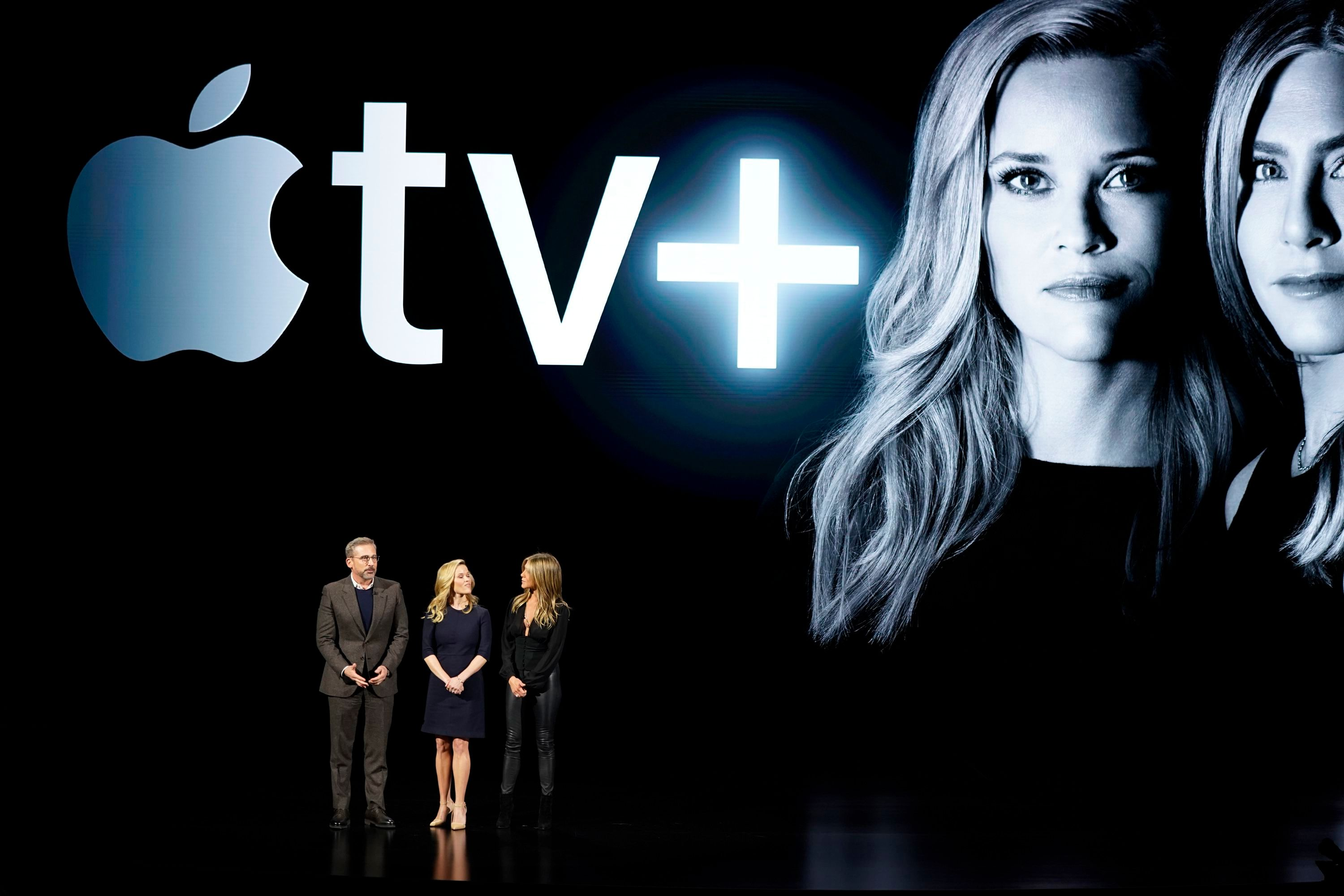 From left, Steve Carell, Reese Witherspoon and Jennifer Aniston speak at the Steve Jobs Theater during an event to announce new products, in Cupertino, CalifApple Streaming TV, Cupertino, USA - 25 Mar 2019