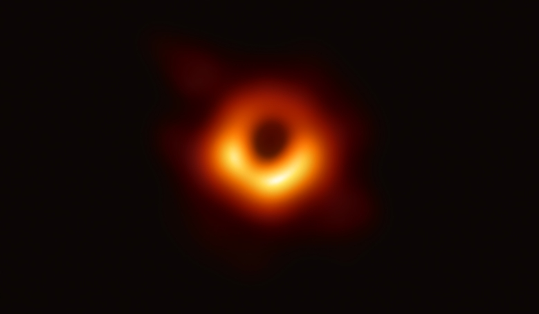 Editorial use only. HANDOUT /NO SALESMandatory Credit: Photo by EVENT HORIZON TELESCOPE COLLABORATION/HANDOUT/EPA-EFE/REX/Shutterstock (10196787a) An undated handout photo made available by Event Horizon Telescope Collaboration on 10 April 2019 showing a bright ring formed as light bends in the intense gravity around a black hole that is 6.5 billion times more massive than the Sun. Scientists have obtained the first image of a black hole, using Event Horizon Telescope observations of the center of the galaxy M87. This long-sought image provides the strongest evidence to date for the existence of supermassive black holes and opens a new window onto the study of black holes, their event horizons, and gravity. Astronomers capture first image of a Black Hole, Space, - - 10 Apr 2019