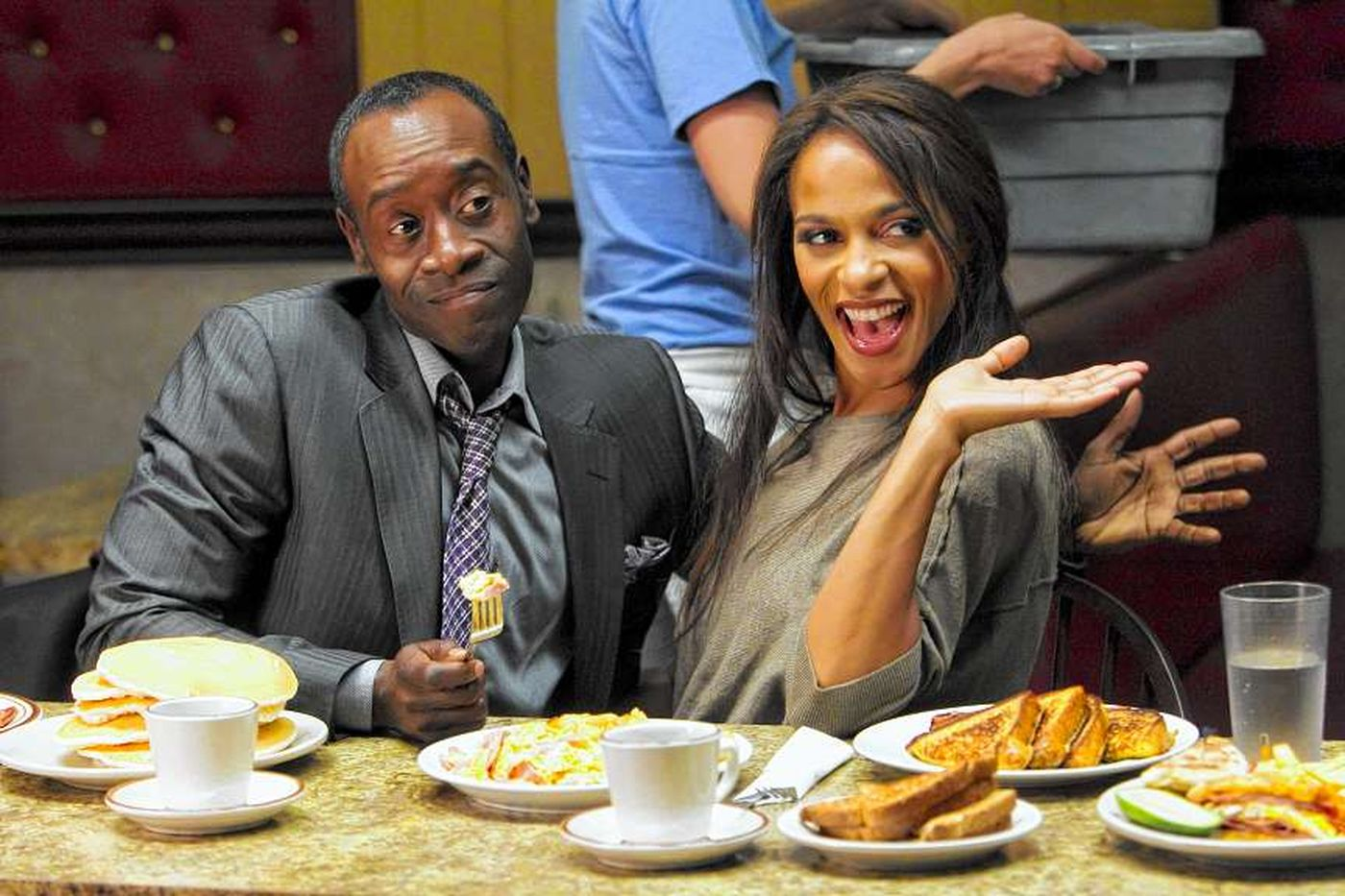Don Cheadle as Marty Kaan and Megalyn Echikunwoke as April in 'House of Lies'