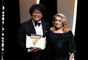 Bong Joon-ho (L) accepts the Palme d'Or (Golden Palm) for the movie 'Parasite' from French actress Catherine Deneuve (R) during the Closing Awards Ceremony of the 72nd Cannes Film Festival, in Cannes, France, 25 May 2019. The Golden Palm winning movie will be screened after the closing ceremony.Closing Award Ceremony - 72nd Cannes Film Festival, France - 25 May 2019