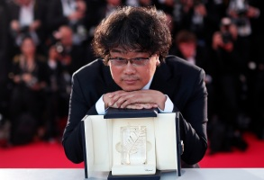 Bong Joon-ho poses with his Palme d'Or (Golden Palm) for the movie 'Parasite' during the Award Winners photocall at the 72nd annual Cannes Film Festival, in Cannes, France, 25 May 2019.Award Winners Photocall - 72nd Cannes Film Festival, France - 25 May 2019