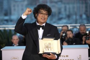 Director Bong Joon-ho poses with the Palme d'Or award for the film 'Parasite' during a photo call following the awards ceremony at the 72nd international film festival, Cannes, southern France2019 Awards Photo Call, Cannes, France - 25 May 2019