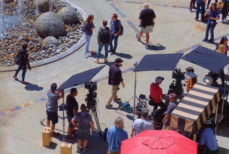 Production crew, extras, and camera operators get ready to film an episode of NCIS:Los Angeles on location in Los Angeles on Monday May, 1, 2017Location Filming, Los Angeles, USA - 01 May 2017