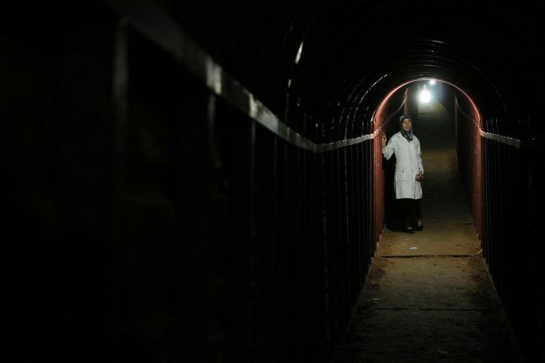 Ghouta, Syria - Dr. Amani in the underground tunnels. (Photo credit:  National Geographic)