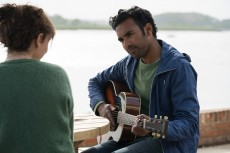 "(from left) Ellie (Lily James, back to camera) and Jack Malik (Himesh Patel) in ""Yesterday,"" directed by Danny Boyle."