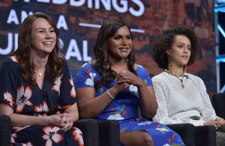 "Tracey Wigfield, Mindy Kaling, Nathalie Emmanuel. Showrunner/executive producer Tracey Wigfield, from left, co-creator/executive producer Mindy Kaling and Nathalie Emmanuel participate in Hulu's ""Four Weddings and a Funeral"" panel at the Television Critics Association Summer Press Tour, in Beverly Hills, Calif2019 Summer TCA - Hulu, Beverly Hills, USA - 26 Jul 2019"